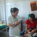 Dr. Pham Thi Cam Van with patient